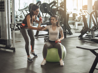 A woman working with a personal trainer in Tyler, TX